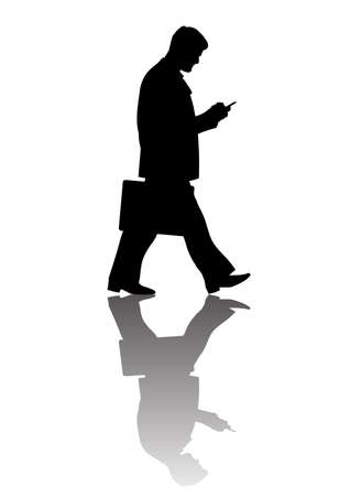 Walking businessman with suitcase looking at smartphone, full length silhouette with reflection