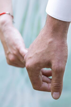 man and woman hold hands history of relationships