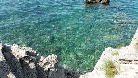 aquamarine water and stone stairs in Budva Montenegro Stock Photo - 106303102