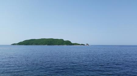 Sveti Nikola island on skyline of Adriatic sea
