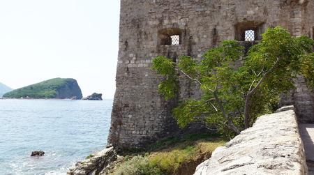 stone wall of Old Town in Budva and Sveti Nikola Island - Montenegro Stock Photo
