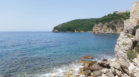 aquamarine water and cliffs in Budva Montenegro