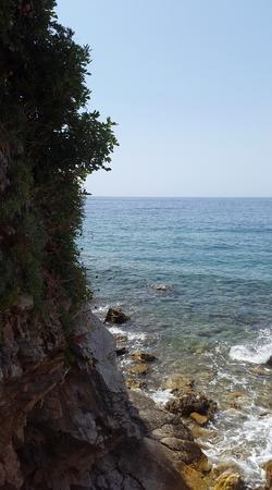 aquamarine water in bay near Budva and stones - Montenegro