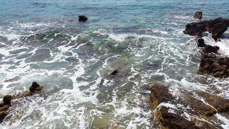 dark stones and aquamarine water - Adriatic sea in Montenegro Stock Photo