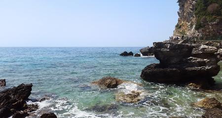 big stones and transparent water with white foam - Adriatic sea near Budva