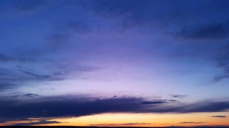 bright blue sky with orange sunset at evening Standard-Bild