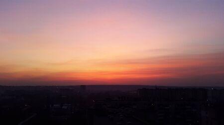 orange evening sunset over dark city Standard-Bild
