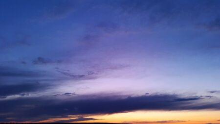 dark blue and violet sky with orange sunset at evening Banque d'images - 145590241