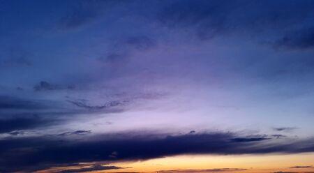 dark blue sky with bright orange sunset  Standard-Bild