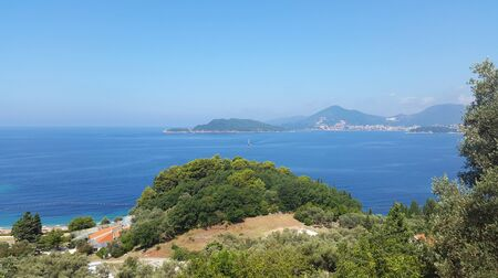 green landscape under blue sky and Adriatic sea of Montenegro