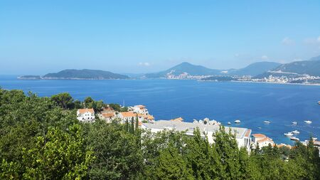 blue Adriatic sea and green hills near Budva and Becici - resort of Montenegro Banque d'images - 147183570