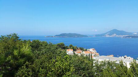 Adriatic sea and green hills near Budva and Becici - landscapes of Montenegro Standard-Bild