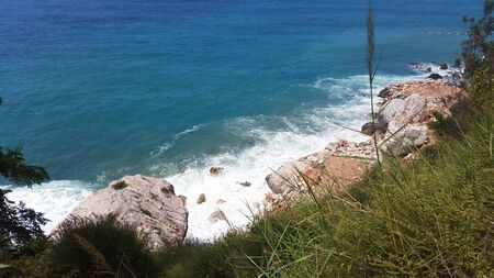 white foam and blue water of Adriatic sea and rocks on Montenegro coast at summer Banque d'images - 148090166