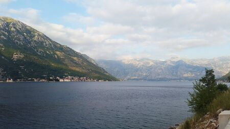 Bay of Kotor - green landscape and dark water under clouds Banque d'images - 148685253
