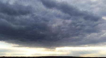 large dark blue gloomy cloud and sunlights
