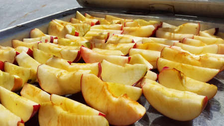 apples sliced and drying on air