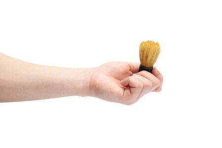 Shaving brush in hand on a white background Zdjęcie Seryjne