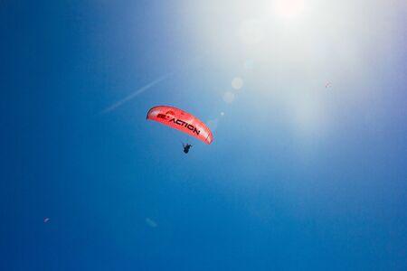 Paragliding in sunny weather on Oludeniz beach, Fethiye, Turkey – 07 Jun 2018. Blue Lagoon near Babadag Mountain, popular resort and paragliding spotю Film grain effect