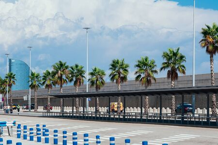 Sea Port of Barcelona, Spain - September 7, 2018. Car traffic inside Port De Barcelona, next to a terminal, port workers and travelers arriving to board on ships. Travel to Europe concept 에디토리얼
