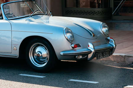 Monte-Carlo, Monaco, - September 09, 2018: a convertible luxury gray car Porsche 356 parked in the street, close up view, shop window in the background. French Riviera drive 에디토리얼