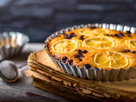 pie de limon: Lemon pie on a metal dish. Plate stands on an old book. selective focus