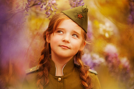 may 9: cute little girl in a military uniform