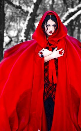 caperucita roja: Vintage photo. girl in a long red coat walks on l ESU. Little Red Riding Hood Foto de archivo