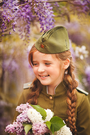 little girl in a military uniform