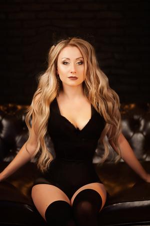 glamorous photo of a beautiful blonde in black