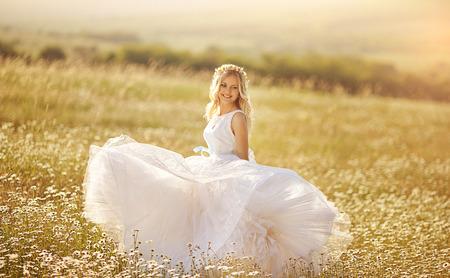 beautiful blonde in a chamomile field