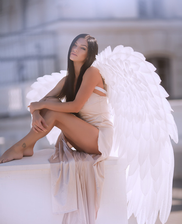 Fine art photo of a woman in white dress as an angel Archivio Fotografico