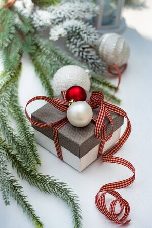 Christmas gift concept with bright ribbon and fir tree on wooden background with copy space Stockfoto