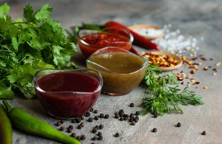 Traditional georgian sauces on stone background on stone background