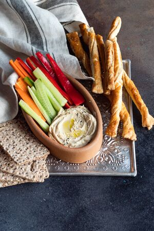 hummus vegetarian dish on Rustic background with copy space