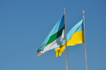 Ukraine national and Rivne municipal flags flattering 스톡 콘텐츠