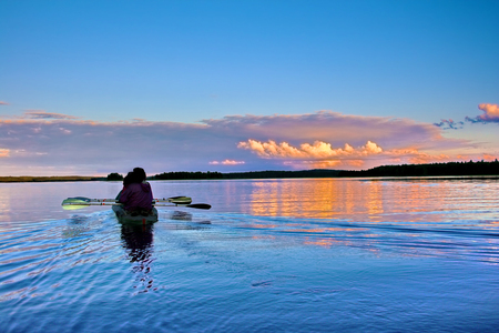 Kayaking on a lake at sunset, Karelia