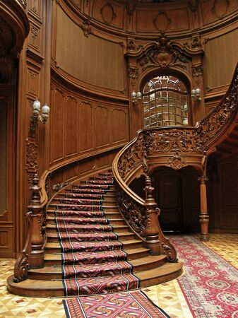 LVIV, UKRAINE - MAY 1: A carved wooden staircase in ancient casino on May 1, 2010 in Lviv, Ukraine Éditoriale
