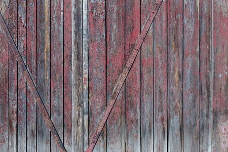Red wooden boards or fence texture background or backdrop with old paint