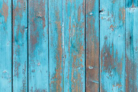 Blue wooden boards or fence texture background or backdrop with old paint