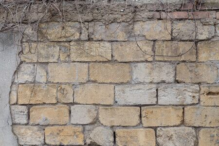 Dirty uneven brickwall texture background or backdrop with stains and cement smears Stockfoto