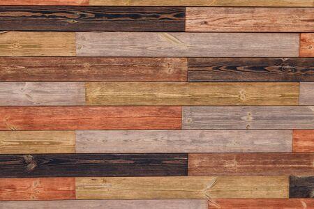 Tablas de madera marrón o fondo de textura de valla o telón de fondo con pintura vieja