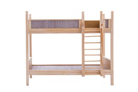 Toy wooden bunk bed for a doll isolated on white background