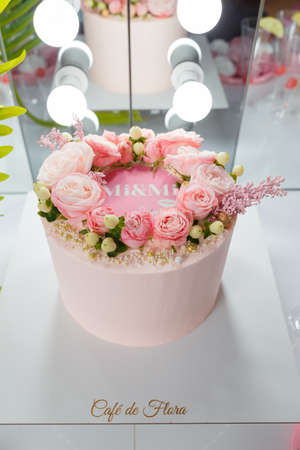 Izmail, Ukraine, August 2020. Beautiful pink cake with rose flowers. Birthday party, anniversary celebration or festive event.