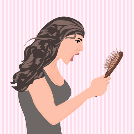 Young beautiful woman worried about hair loss holding comb looking at it
