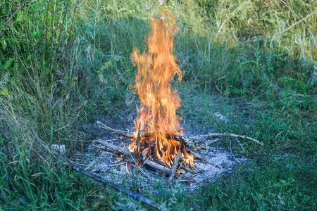 Campfire ona grass preperation  for  camping 写真素材