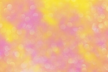 Decorative abstract festive pink yellow background with bokeh lights 写真素材