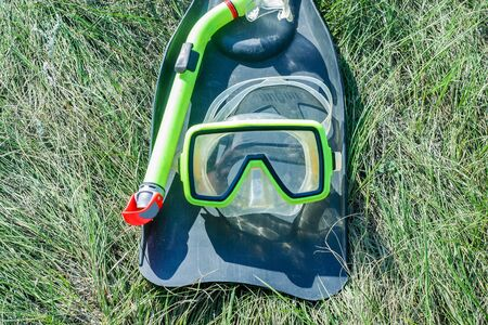 underwater mask and flippers diver equipment  lying on the grass 写真素材