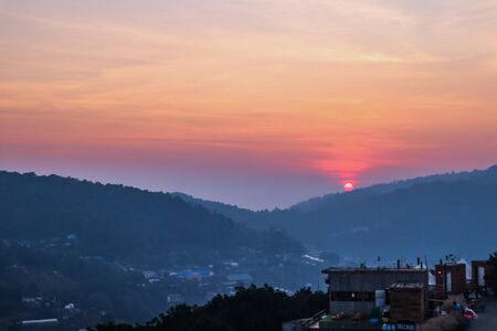 Vivid sunset in a thai village near mountains in Chiang Mai, Thailand. The mountain scenery view