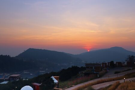 Majestic sunset in the mountains in Chiang Mai, Thailand. The mountain scenery view 写真素材
