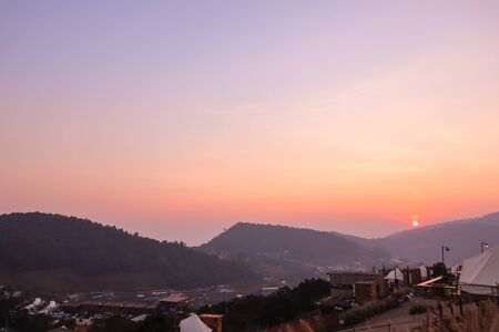 Colorful sunset over the mountain hills in a thai village near mountains in Chiang Mai, Thailand. The mountain scenery view